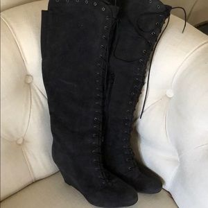 Stuart Weitzman tall lace up suede boots.